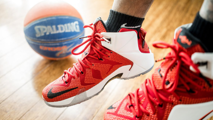 red nike shoes and a basketball