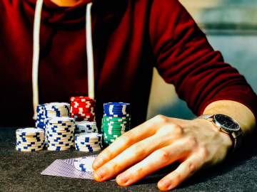 Poker player stacking his chips.