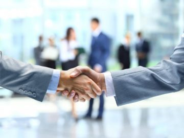 Industry professionals shaking hands