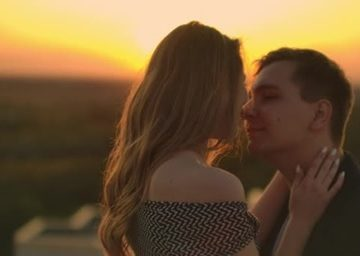 Couple in an embrace during sunset