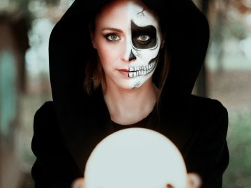 Portrait of girl during halloween holding a moon