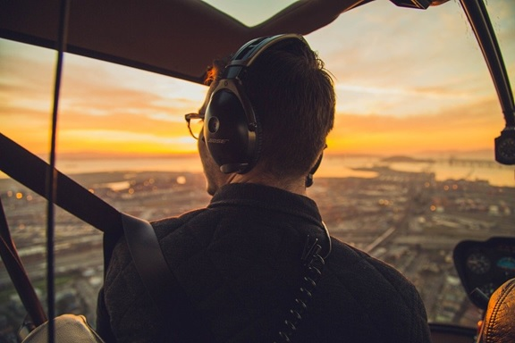 An image of a man inside a helicopter