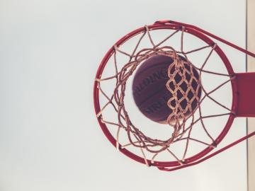 A basketball above a hoop