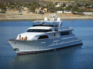 People enjoying a luxury yacht charter in Cabo San Lucas.