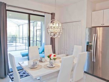 dining table and kitchen amenities in a vacation home near Disney World