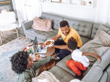 parents with kid enjoying at home