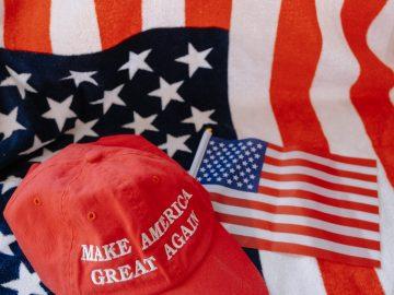 MAGA cap on the American flag.