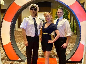 costumed performers at a Love Boat themed party