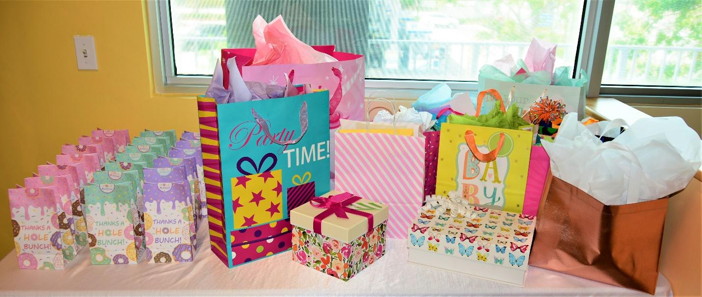 Assorted birthday bags and gifts on the table