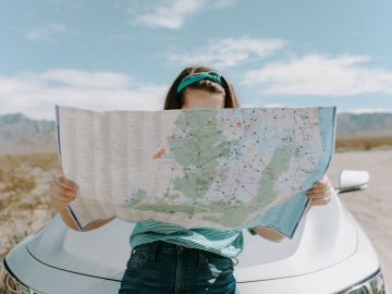 Woman holding a map.