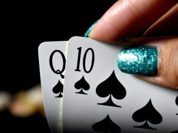 a person holding playing cards