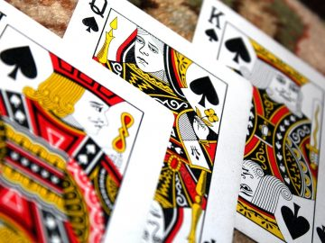 three playing cards in a game of Teen Patti