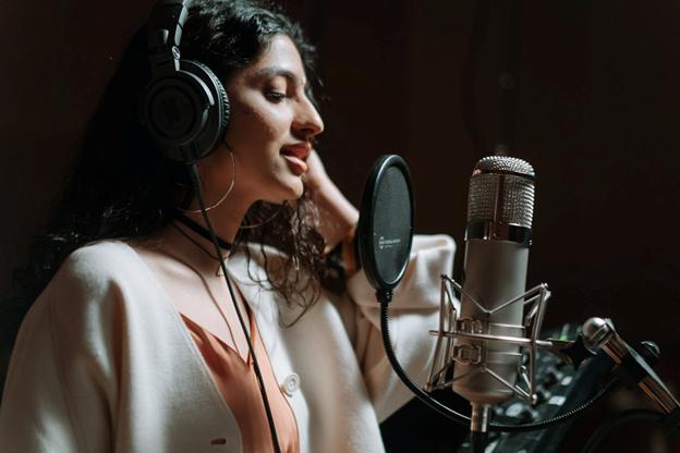 a person recording a voiceover in a recording studio