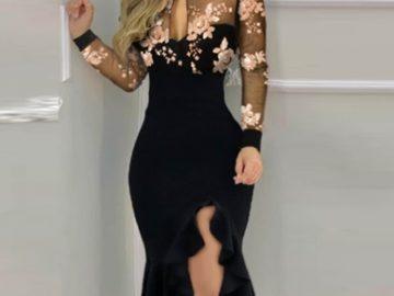 A woman wearing a black party dress.