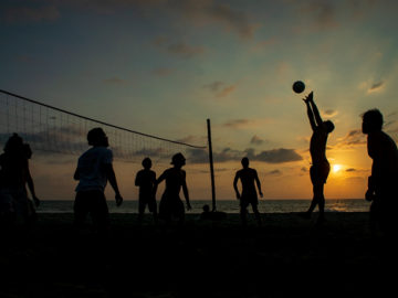 A group of people playing volleyball