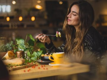 Woman smiling at a restaurant